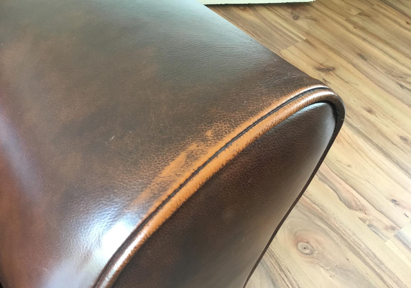 worn leather sofa arm