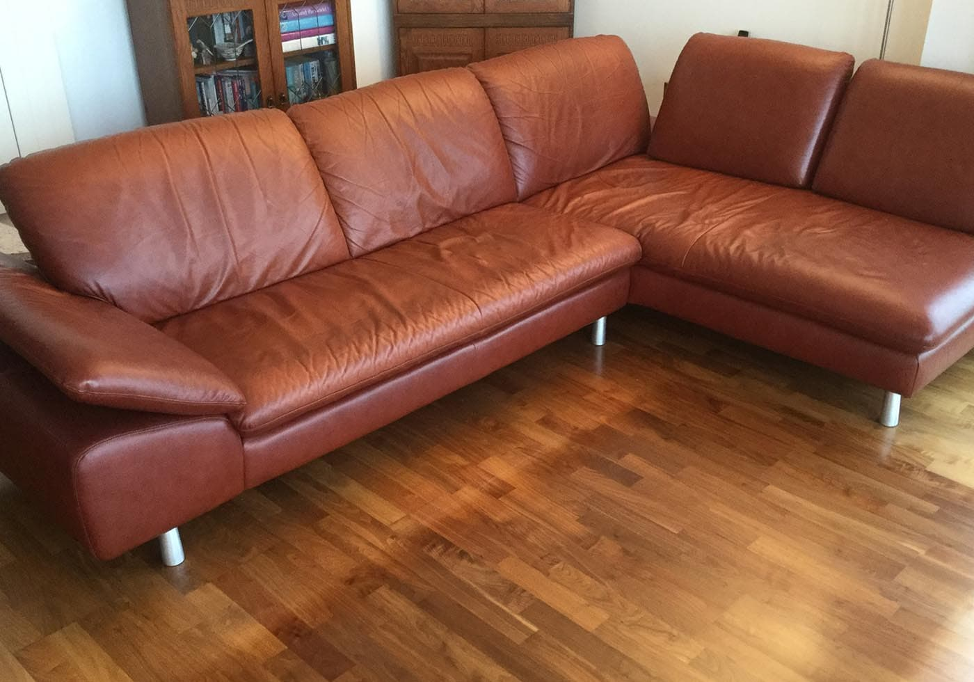 leather corner sofa with sagging cushions