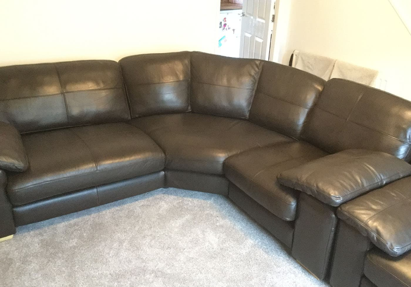 black leather sofa with new cushions